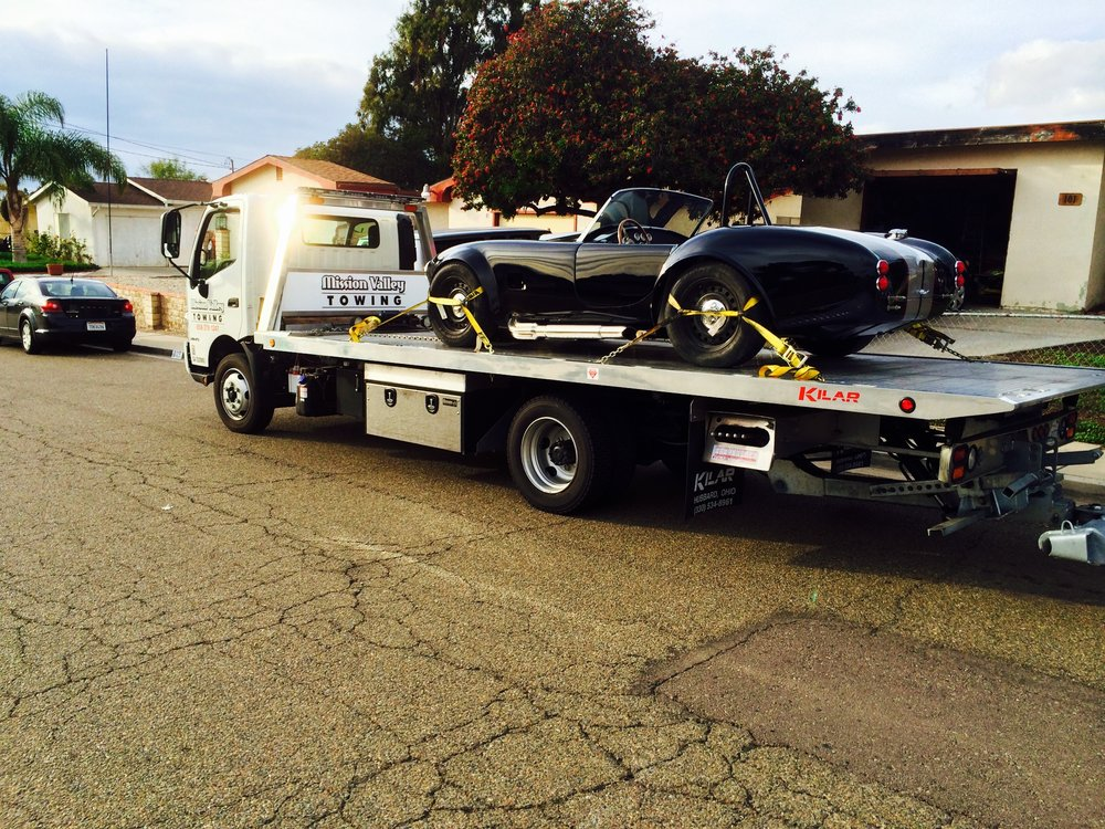 Towing Vehicles With Flat Bed Trucks